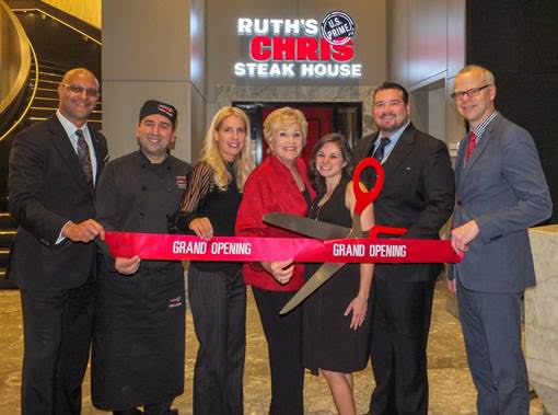 Co-Franchisees Lana Duke and R. David Duke marked the Grand Opening of their third Ruth's Chris Steak House in the GTA, located in the Marriott Markham Hotel at 170 Enterprise Blvd in 'Downtown Markham. Joining in the ribbon cutting festivities (right to left) Ruth's Chris-Markham General Manager Mike Berlanguet, R. David Duke, Lori Duke, Lana Duke, Director of Sales & Marketing Sara Wilde, Executive Chef Ibrahim Hodroj and Toronto Marriott Markham General Manager Hiren Prabhakar. (Photo: Darrell Hein)